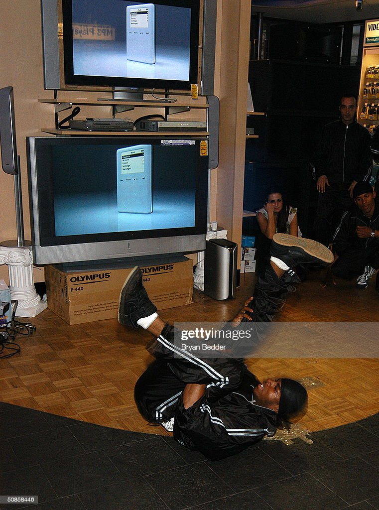 A breakdancer from the Dynasty Rockers performs at the ISkin and DataVision launch event May 19, 2004 in New York City.
