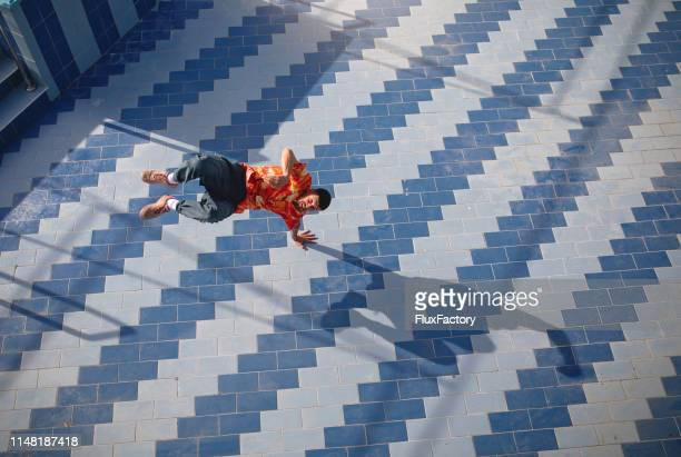 breakdancer showing off his skill and talent - one young man only stock pictures, royalty-free photos & images