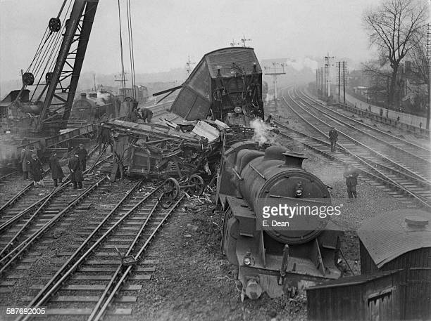 A breakdown gang working to clear the wreckage of a freight train which derailed near West Hampstead north London during its run from Manchester to...