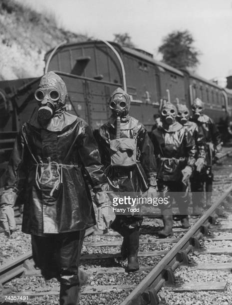 A breakdown squad on a training exercise to rerail a carriage under conditions of a poison gas attack on the Southern Railway England 1st September...