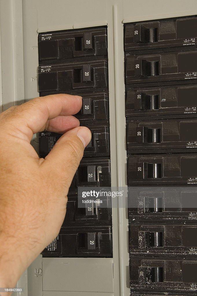 Breaker box and hand : Stock Photo