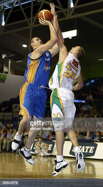 Breakers Ben Pepper looks to shoot over Croc's Casey Calvary during the NBL basketball match between the Breakers and the Townsville Crocodiles...