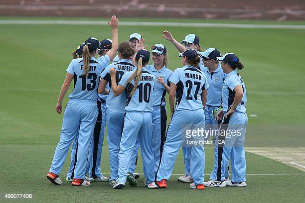 Breakers celebrate a wicket during the WNCL Final match between the New South Wales and South Australia at Hurstville Oval on November 29 2015 in...