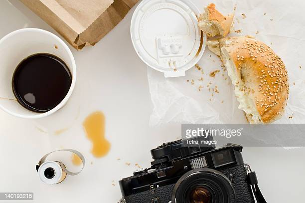 Breakfast and camera on table, studio shot