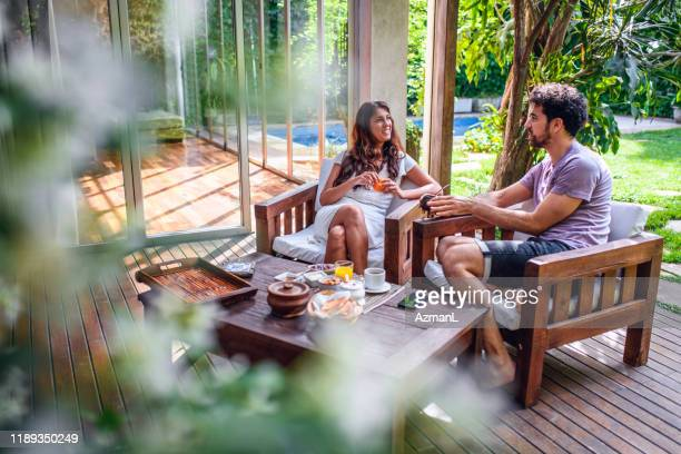 breakfast and relaxing conversation on home deck - patio stock pictures, royalty-free photos & images