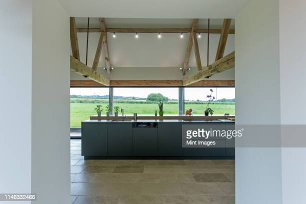 breakfast bar and glass wall in modern kitchen - oxford england stock pictures, royalty-free photos & images
