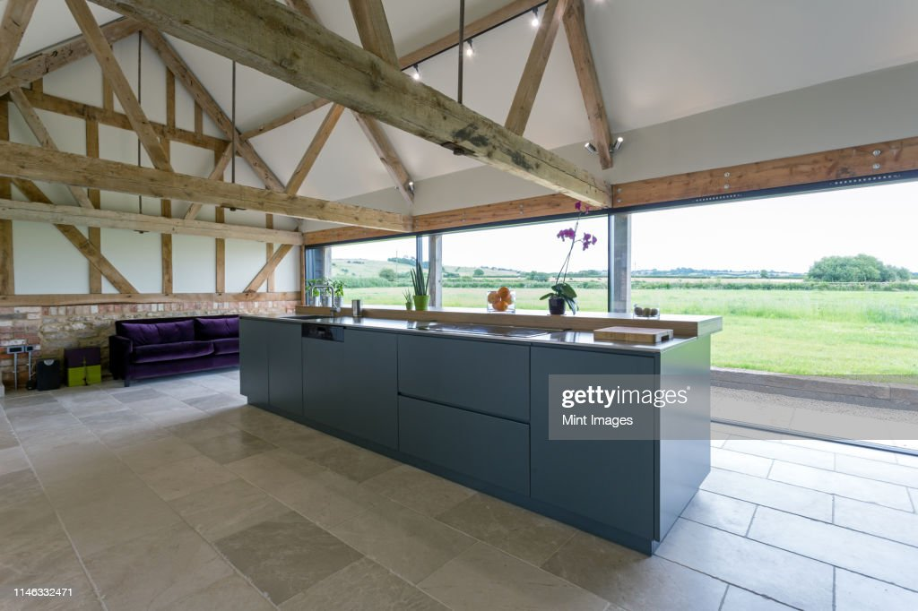 Breakfast Bar And Glass Wall In Modern Kitchen ストックフォト Getty Images