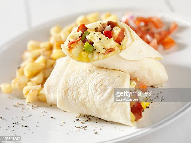 breakfast burrito with hash brown potatoes and salsa - burrito stock pictures, royalty-free photos & images