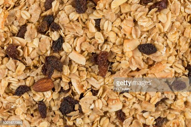 breakfast cereals background texture close up shot - granola stock pictures, royalty-free photos & images