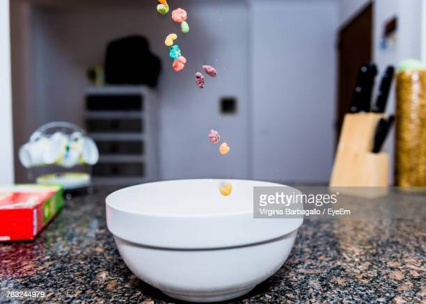 Breakfast Cereals Falling In Bowl On Table
