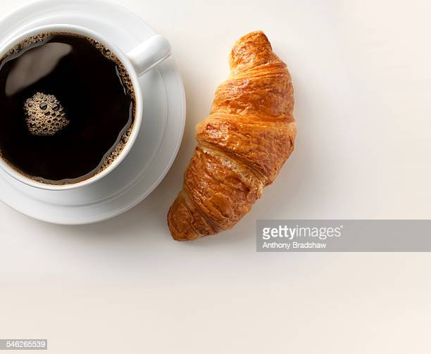 Breakfast coffee and croissant