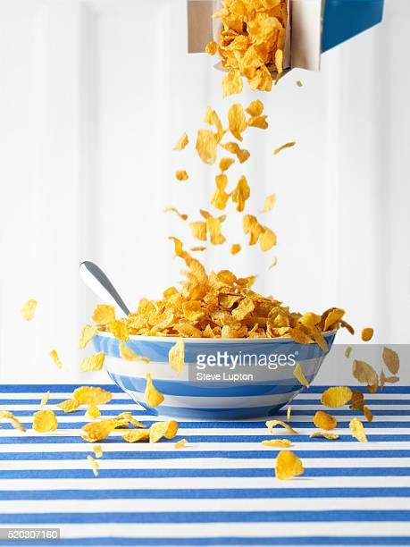 Breakfast Corn Flakes Cascading into Bowl