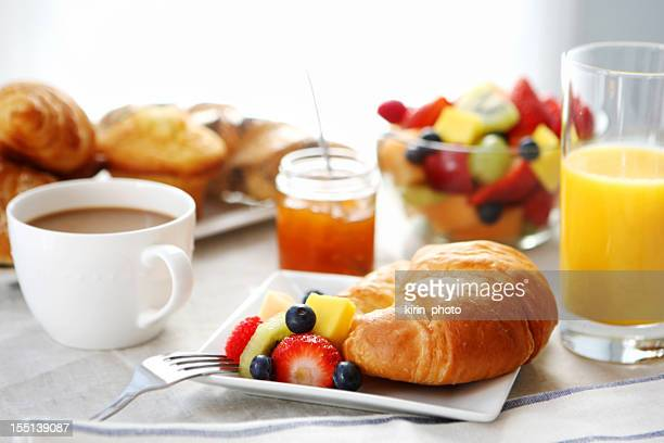 breakfast- croissant, fruit salad and coffee