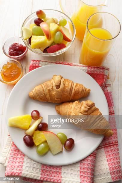 Breakfast: Croissant, Fruit Salad and Orange Juice Still Life