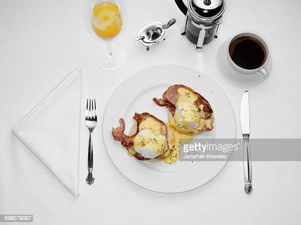 Breakfast, eggs Benedict on white