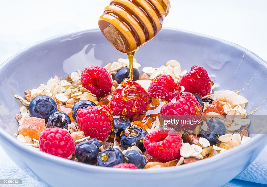 Breakfast healthy bowl with muesli and berries. : Stock Photo