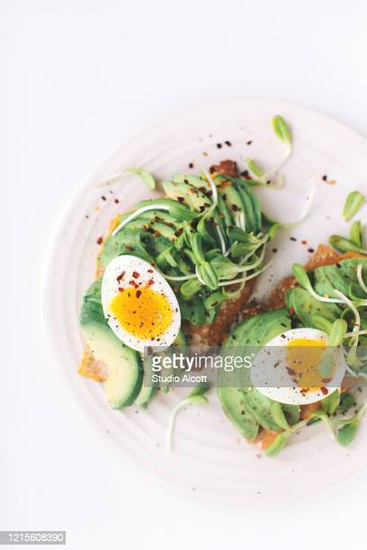 breakfast in bed - avocado toast stockfoto's en -beelden