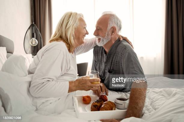 breakfast in bed - anniversary stock pictures, royalty-free photos & images