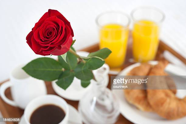 Breakfast in bed with rose, white background