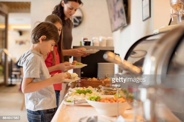 breakfast in hotel restaurant - buffet stock pictures, royalty-free photos & images