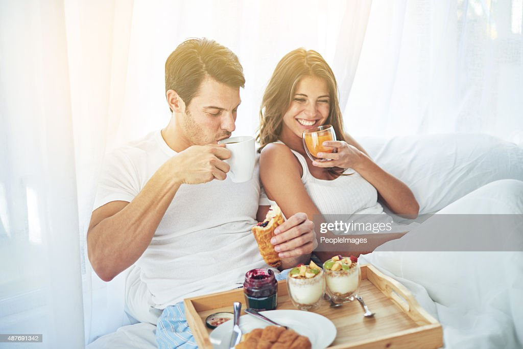 Breakfast is better when you share it in bed : Stock Photo