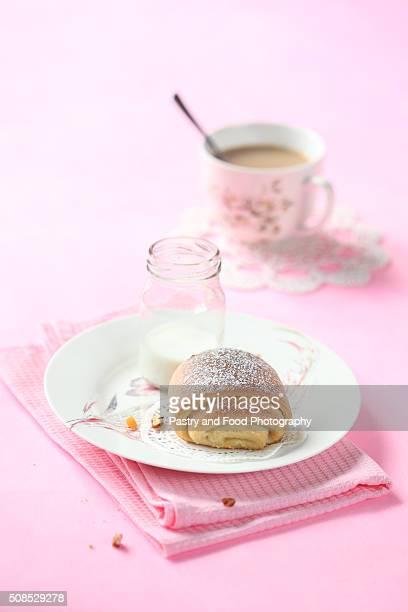 Breakfast - Marzipan Bun, bottle of milk and cup of coffee