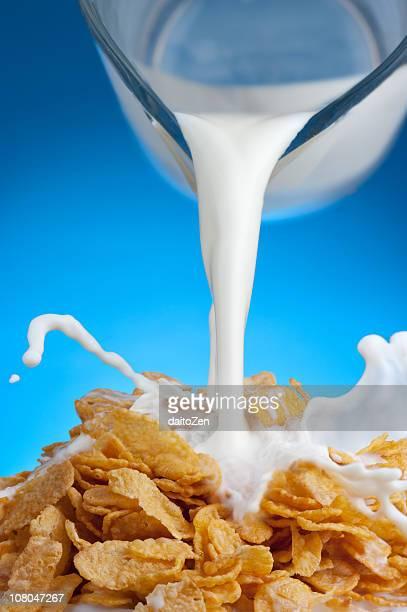 breakfast milk splash - milk pour stock photos and pictures