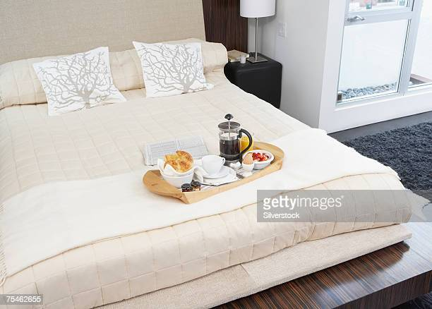 Breakfast on tray on hotel bed