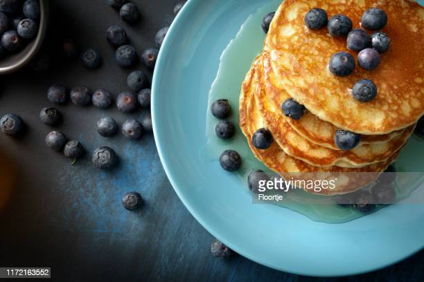 breakfast: pancakes, syrup and blueberries still life - pancakes stock pictures, royalty-free photos & images
