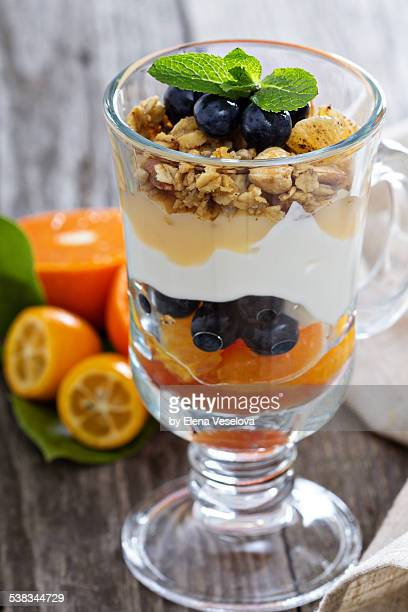 Breakfast parfait with granola and yogurt vertical