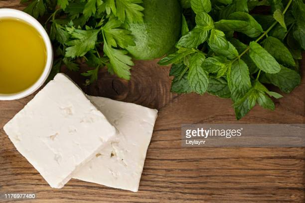breakfast preparation feta cheese, olive oil and slice bread on the wooden - feta cheese stock pictures, royalty-free photos & images