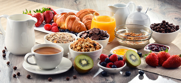 Breakfast served with coffee, juice, croissants and fruits 650279724