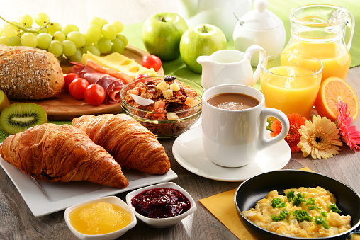 Breakfast served with coffee, juice, egg, and rolls 625232510