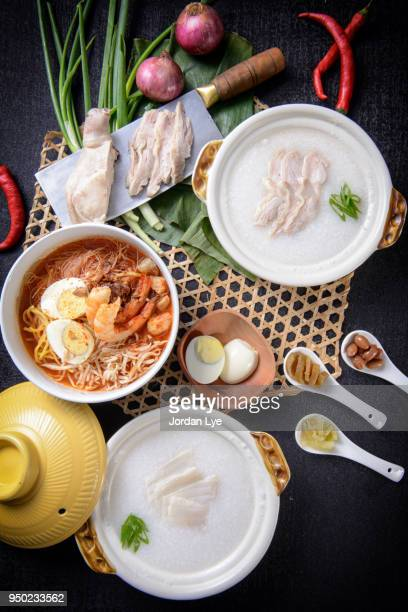breakfast set with oriental food - congee stock photos and pictures