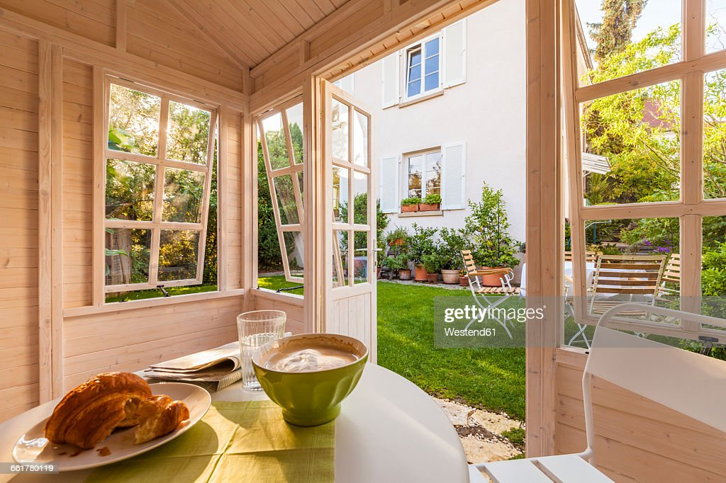 Breakfast table in a garden shed : Stock Photo