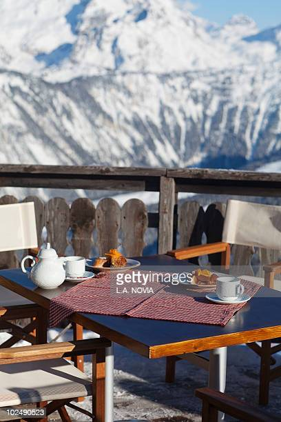 breakfast table in a restaurant terrace, courchevel, alps, france - courchevel stock pictures, royalty-free photos & images