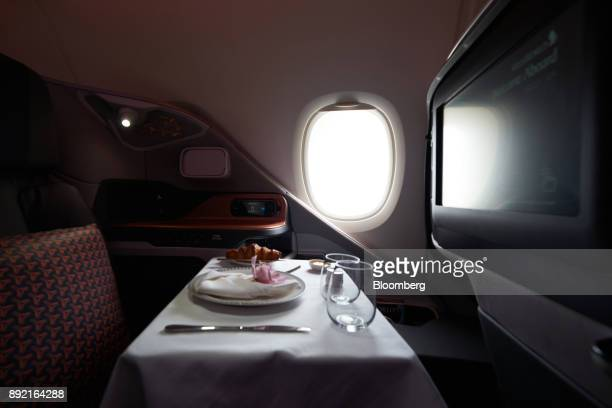 A breakfast table is prepared for a business class seat of a Singapore Airlines Ltd Airbus SE A380 aircraft with refitted cabins during a media tour...