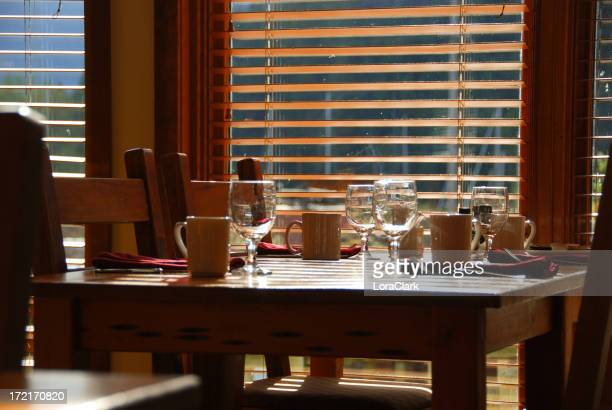 A breakfast table set with glassware