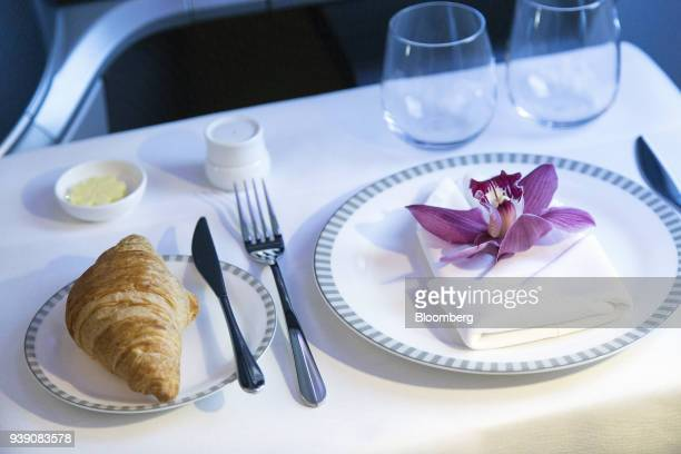 A breakfast table setting is arranged in a business class seat onboard a Singapore Airlines Ltd Boeing 78710 Dreamliner aircraft during a media tour...