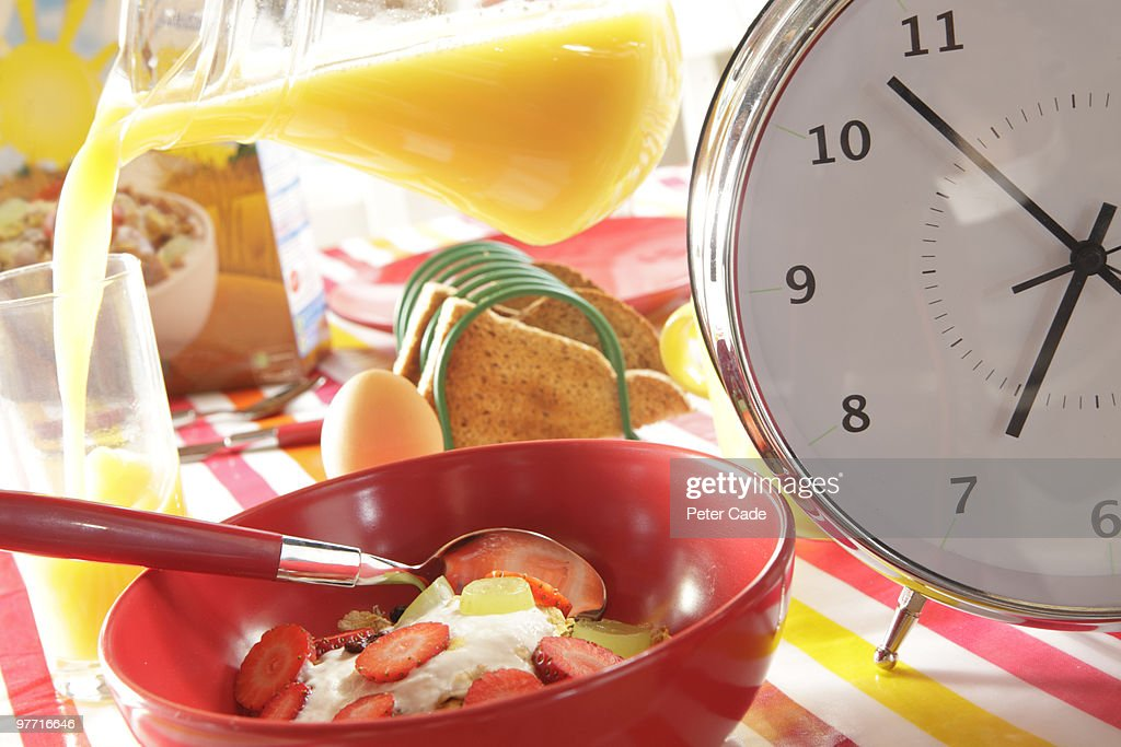 Breakfast Table With Large Clock : Stock Photo