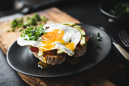 Breakfast toast with avocado, fried egg and sprouts - gettyimageskorea