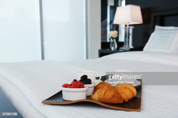 Breakfast tray on freshly made bed