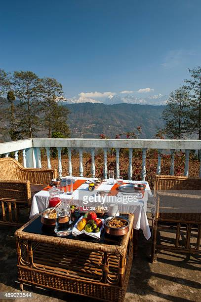 Breakfast with a view over the Himalayas at Shakti Himalaya's home stay in the village of Hee in Sikkim India