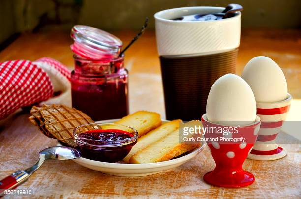 Breakfast with artisanal cheese, eggs, waffles, raspberry and sage sauce and coffee