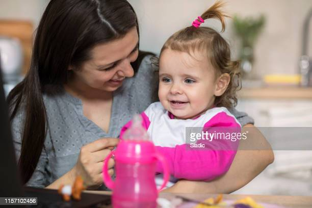 breakfast with baby daughter - childhood stock pictures, royalty-free photos & images