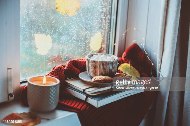 breakfast with books and sweater on window sill at home - candlelight stock pictures, royalty-free photos & images