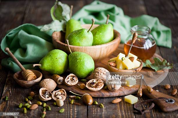 breakfast with cheese, fruit and nuts - anna verdina stock photos and pictures