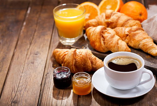 breakfast with cup of coffee and croissants 914599660
