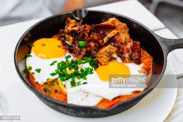 Breakfast with eggs and bacon, served in the skillet