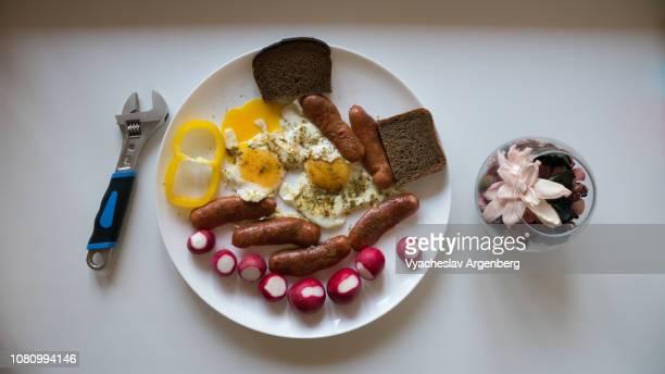 breakfast with eggs and sausages - argenberg stock-fotos und bilder